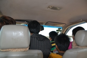 shared taxi..driver is the striped shirt