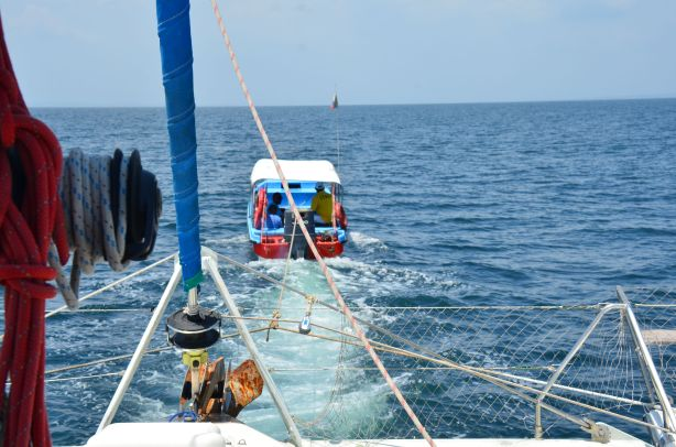 being pulled by fishing boat